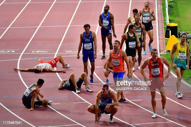 Athletes react after the Men's 1500m Decathlon final at the 2019 IAAF Athletics World Championships at the Khalifa International stadium in Doha on...