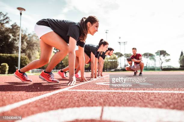 athletes reading to start on the track - beginnings stock pictures, royalty-free photos & images