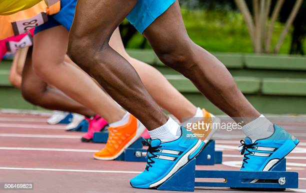 athletes ready to run - sport set competition round stock photos and pictures
