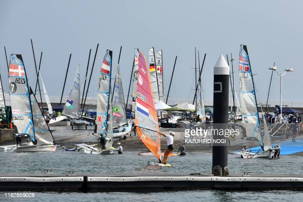 Athletes return at Enoshima Yacht Harbour in Kanagawa Prefecture on August 20 2019 after their competition during a sailing test event for the Tokyo...