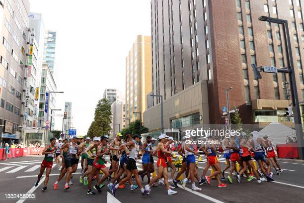 Athletes round a bend during the Men's 20km Race Walk on day thirteen of the Tokyo 2020 Olympic Games at Sapporo Odori Park on August 05, 2021 in...
