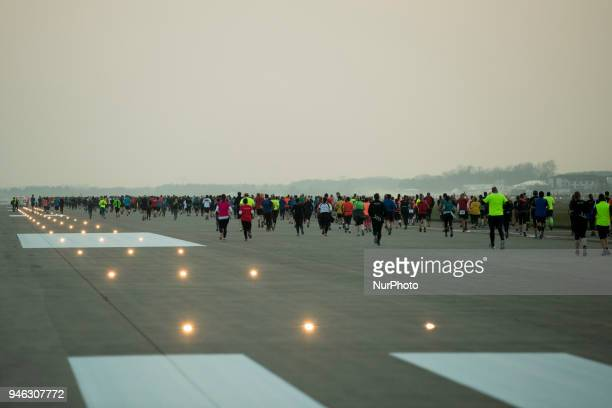 Athletes run during the 12th Airport Night Run at Berlin Brandenburg Airport in Schoenefeld Germany on April 14 2018 Over 6000 people attended this...