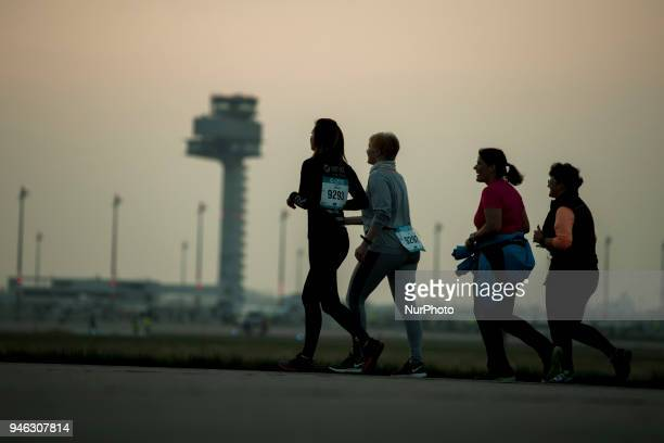Athletes run during the 12th Airport Night Run at Berlin Brandenburg Airport in Schoenefeld, Germany on April 14, 2018. Over 6000 people attended...