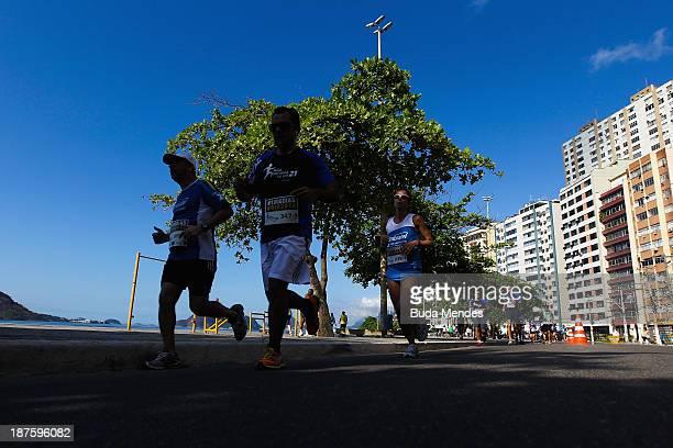 Athletes run during the Half Marathon Faz um 21 Embratel at Orla de Niteroi on November 10 2013 in Rio de Janeiro Brazil