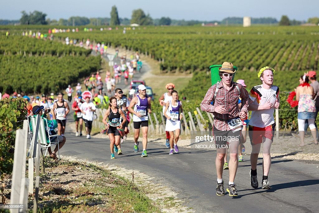 Athletes run past Medoc's vineyards, near Pauillac, during the 30th Marathon du Medoc, a 26-mile (42.2km) circuit in the Medoc wine region near Bordeaux in south-western France which takes in more than 30 of the regions' chateaux and vineyards, on September 13, 2014. The Medoc region's world-famous chateaux include Chateau Lafite Rothschild, Chateau Mouton Rothschild and Chateau Latour, all open their grounds and cellars to offer runners some of the world's most respected wines at 23 drinks stations along the route, as well as countless food stops serving local delicacies from foie gras, oysters and entrecote steak, to ham, cheese and fruit.