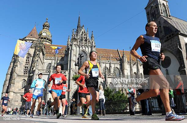Athletes run past Saint Elizabeth's Cathedral during the Peace Marathon in Kosice on October 3 2010 Gilbert Kiptoo Chepkwony of Kenya won the oldest...