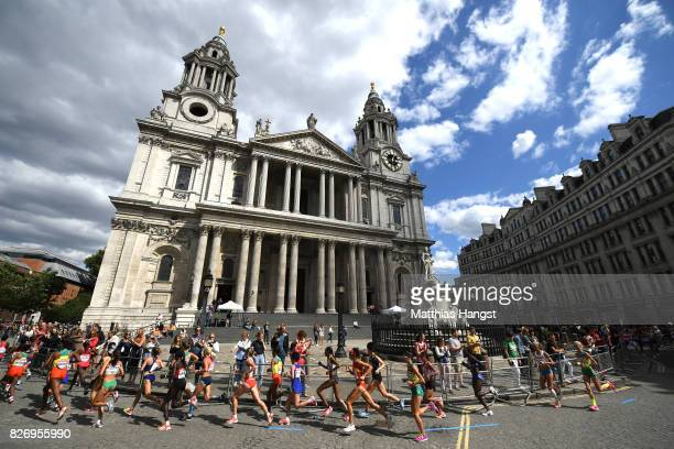 Athletes run past the Queen Anne statue at St Paul's Cathedral during the Women's Marathon on day three of the 16th IAAF World Athletics...