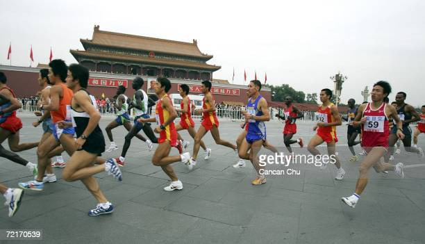 Athletes run past the Tiananmen Gate during the 2006 ANA Beijing International Marathon October 15 2006 in Beijing China Beijing will host the 2008...