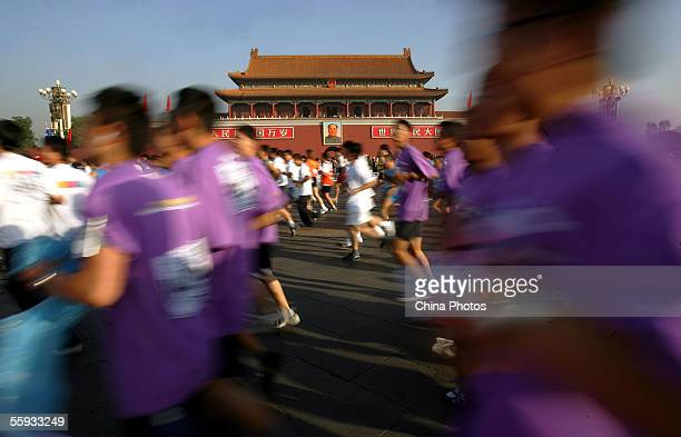 Athletes run past the Tiananmen Gate during the Beijing International Marathon on October 16 2005 in Beijing China The event has attracted 38 world...