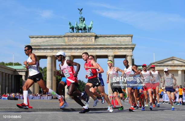 Athletes run through the Brandenburg Gate in the Men's Marathon final during day six of the 24th European Athletics Championships at Olympiastadion...