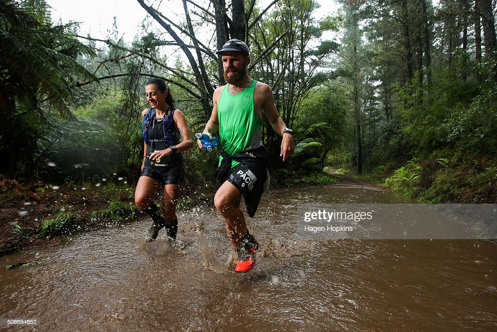 Athletes run through water during the Tarawera Ultramarathon on February 6, 2016 in Rotorua, New Zealand.