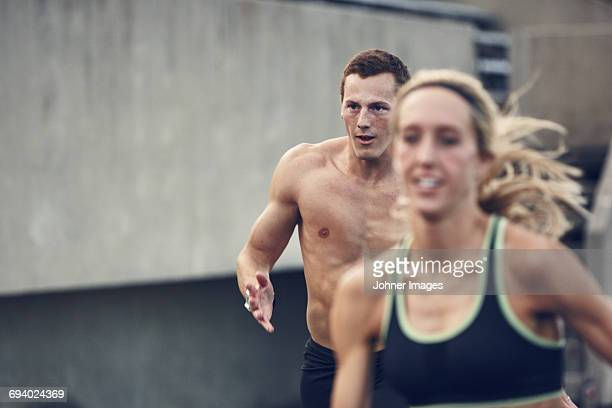 athletes running at stadium - center athlete stock pictures, royalty-free photos & images