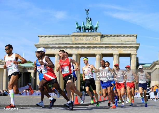 Athletes running in front of the Brandenburg Gate at the Men's Marathon final race during the 2018 European Athletics Championships at Potsdamer...