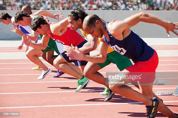 Athletes running on sports track