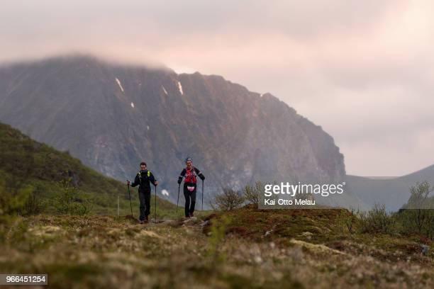 Athletes running past Offeroyskammen at The Arctic Triple Lofoten UltraTrail on June 2 2018 in Svolvar Norway Lofoten UltraTrail is one of three...