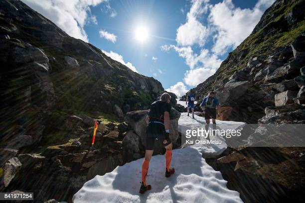 Athletes running up the snowy parts of the trail at Hardangervidda Marathon on September 2 2017 in Eidfjord Norway Hardangervidda Marathon goes...