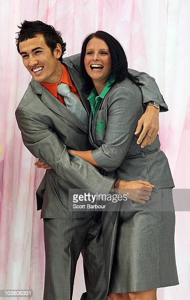 Athletes Sean Wroe and Leisel Jones pose during the unveiling of the 2010 Australian Commonwealth Games Uniform at Melbourne City Square on September...
