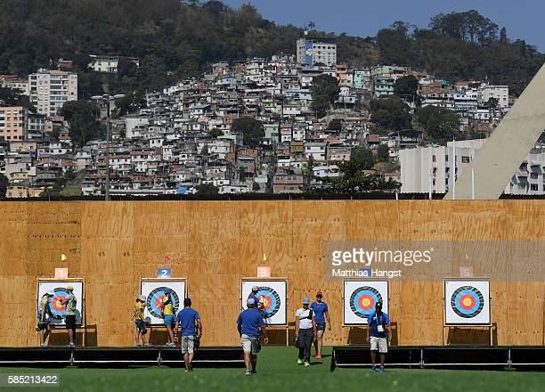 Athletes seen in front of the favela Morro da Mineira during a training session at the Sambodromo Olympic Archery venue on August 2 2016 in Rio de...