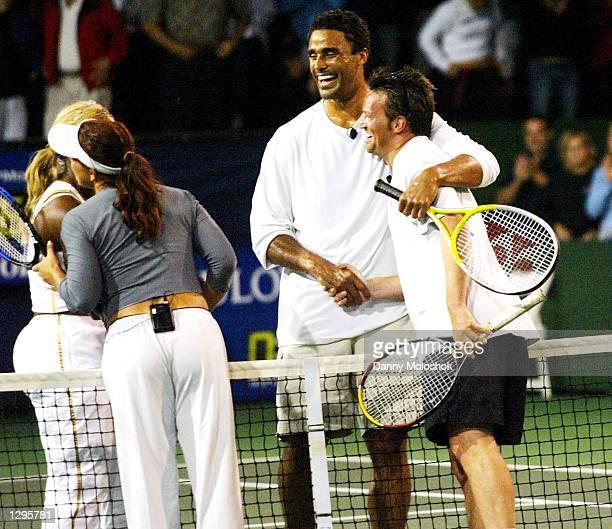 Athletes Serena Williams Jennifer Capriati Rick Fox and actor Matthew Perry hug after playing in the JPMorgan Chase Open at the Manhattan Beach...