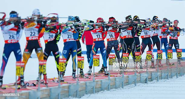 Athletes shoot during the IBU Biathlon World Cup Men's Pursuit on December 15 2013 in AnnecyLe Grand Bornand France