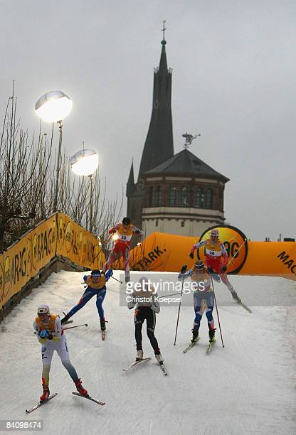 Athletes skate during the men's sprint of the FIS Cross Country World Cup at the Dusseldorf city circuit on December 20 2008 in Duesseldorf Germany