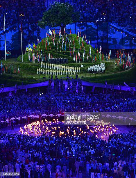 Athletes stand during the speeches during the opening ceremony of the London 2012 Olympic Games on July 27 2012 at the Olympic stadium in London AFP...