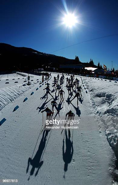 Athletes start the men's biathlon 15 km mass start on day 10 of the 2010 Vancouver Winter Olympics at Whistler Olympic Park Cross-Country Stadium on...