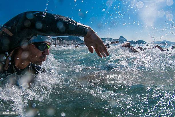 Athletes start the men's open water swimming competition during the Rei e Rainha do Mar 2014 at Copacabana beach on August 31 2014 in Rio de Janeiro...