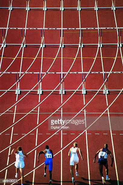 Athletes Starting to Run Hurdles