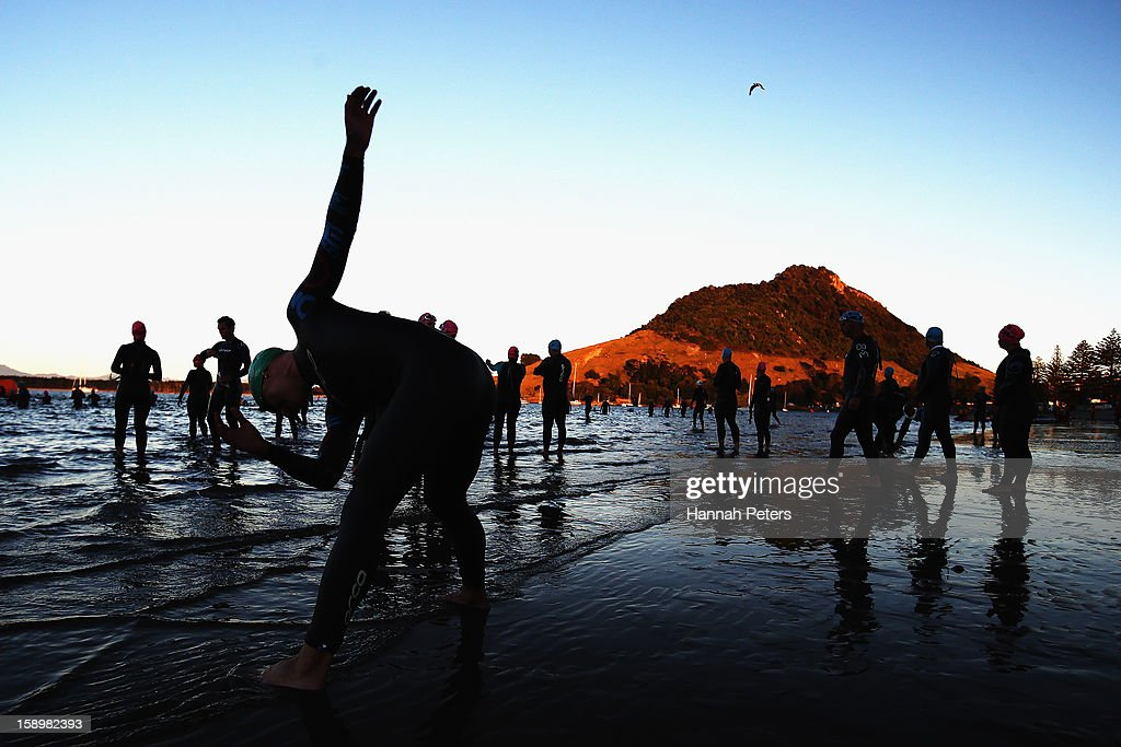 Athletes stretch prior to the start of the Elite Men's race during the Port of Tauranga Half Ironman on January 5, 2013 in Tauranga, New Zealand.