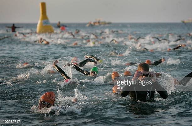 Athletes swim the 38 KM course in the Puerto del Carmen Beach during the the Lanzarote Ironman on May 22 2010 in the spanish canary island of...