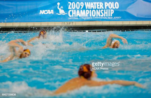 Athletes swim up the pool during the Division I Men's Water Polo Championship held at the DeNunzio Pool on the Princeton University campus in...
