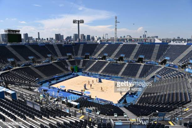 Athletes take part in a practice session at the venue of the beach volleyball competition for the Tokyo 2020 Olympic Games in Shiokaze Park in Tokyo...
