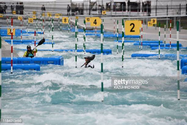 Athletes take part in canoe demonstrations following the grand opening ceremony of the Kasai Canoe Slalom Centre which will host canoe competitions...