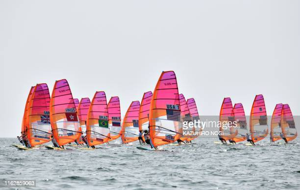 TOPSHOT Athletes take part in the women's windsurfing RSX class competition during a sailing test event for the Tokyo 2020 Olympic Games off the...