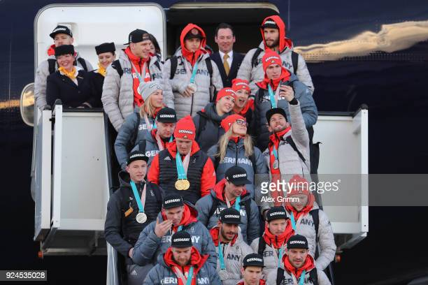 Athletes take photos during the arrival of Team Germany after their return from the 2018 PyeongChang Winter Olympics at Frankfurt International...