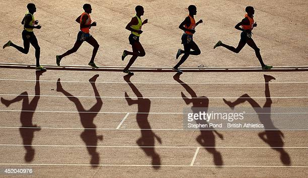 Athletes take the bend during the Men's 5000m event during day one of the Sainsbury's Glasgow Grand Prix Diamond League athletics meeting at Hampden...