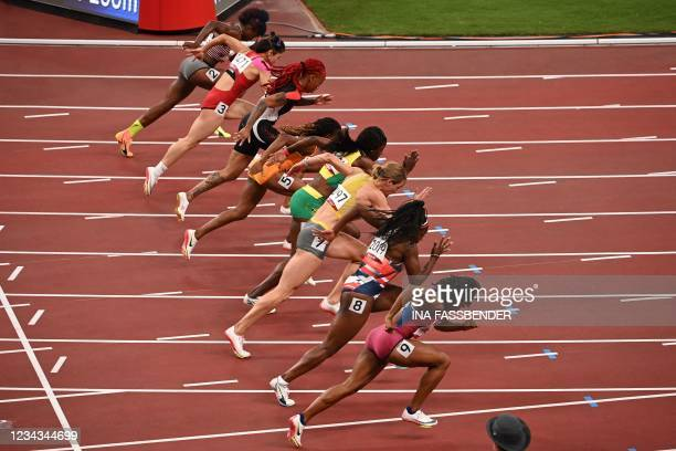 Athletes take the start in the women's 400m hurdles heats during the Tokyo 2020 Olympic Games at the Olympic Stadium in Tokyo on July 31, 2021.