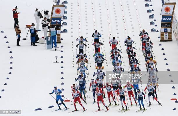 Athletes take the start of the men's 50 km mass start race at the FIS Nordic Ski World Championships in Oberstdorf, southern Germany, on March 7,...