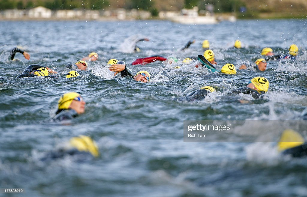 Athletes take to the water the during the Challenge Penticton Triathlon on August 25, 2013 in Penticton, British Columbia, Canada.