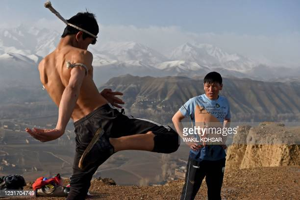 Athletes train in Muay Thai form of martial arts atop the hills of Salsal Buddha, the site of the Buddhas of Bamiyan statues, which were destroyed by...