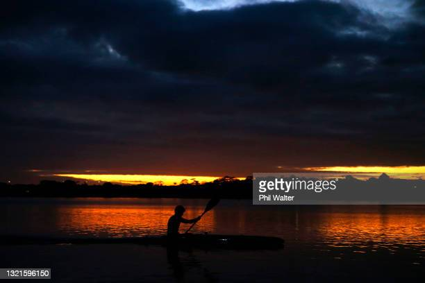Athletes train on Lake Pupuke before the New Zealand Olympic Committee Women's Canoe Sprint announcement at North Shore Canoe Club on June 04, 2021...
