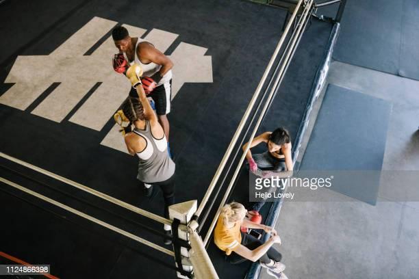 Athletes training at boxing gym