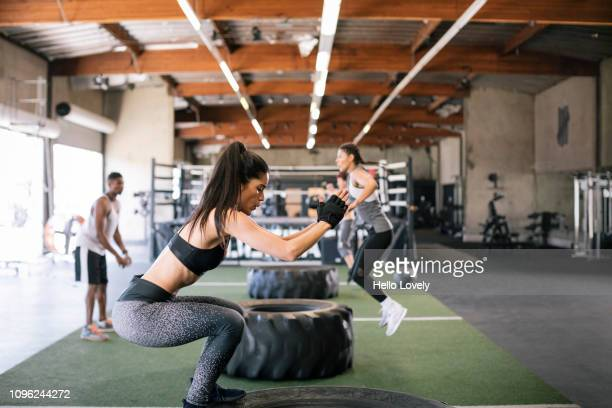 athletes training at gym - small group of people stock pictures, royalty-free photos & images