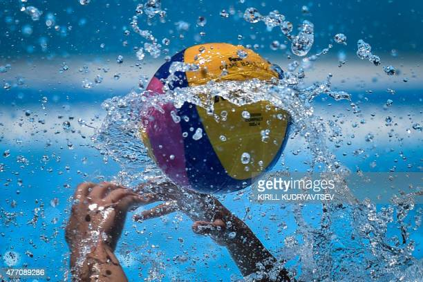 Athletes vie for the ball during the women's water polo Group B preliminary round match Italy vs Serbia at the 2015 European Games in Baku on June 14...
