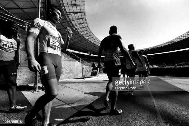 Athletes walk from the call room onto the track during day two of the 24th European Athletics Championships at Olympiastadion on August 8 2018 in...