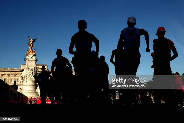 Athletes walk towards Buckingham Palace in the Men's 50km Race Walk final during day ten of the 16th IAAF World Athletics Championships London 2017...