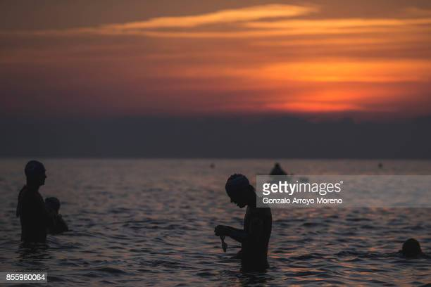 Athletes warm up at sunrise prior to start the swimming course of the IRONMAN Barcelona on September 30 2017 in Calella Barcelona province Spain
