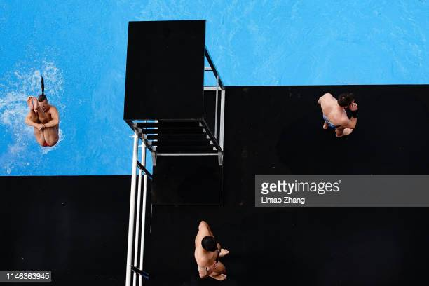 Athletes warm up before competes in the Men's 27m high diving final round on day two of the FINA High Diving World Cup at Zhaoqing High Diving...