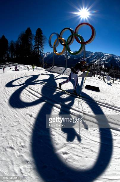 Athletes warm up before the Women's 10 km Classic during day six of the Sochi 2014 Winter Olympics at Laura Crosscountry Ski Biathlon Center on...